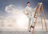Businesswoman climbing the career ladder — Stock Photo