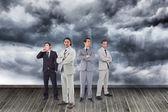 Attractive businessmen standing arms crossed — Stock Photo
