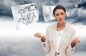 Composite image of confused businesswoman standing — Stock Photo