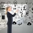 Composite image of businesswoman pointing somewhere — Stockfoto