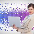 Confident businesswoman with laptop — Stock Photo