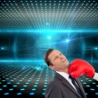 Businesswoman hitting colleague with her boxing gloves — Stock Photo