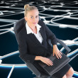 Stock Photo: Businesswomsitting on swivel chair with laptop