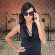 Stock Photo: Elegant brunette wearing sunglasses on phone