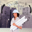Confident woman holding construction plans — Stock Photo