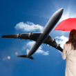 Businesswoman standing back to camera holding red umbrella — Stock Photo