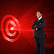Composite image of businessman with folded arms — Stock Photo