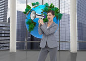 Businesswoman with loudspeaker — Stockfoto