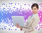 Confident businesswoman with laptop — Stock Photo