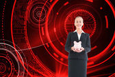 Composite image of businesswoman holding pink piggy bank — Stock Photo