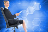 Businesswoman sitting in swivel chair holding folder — Stock Photo