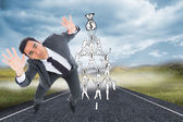 Composite image of unsmiling businessman with arms raised — Stock Photo