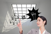 Saleswoman operating touchscreen — Stockfoto