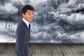 Composite image of smiling casual businessman walking — Foto Stock