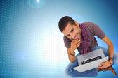Thoughtful man using laptop — ストック写真