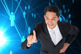 Composite image of smiling asian businessman pointing — ストック写真