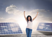 Young happy woman stands with her hands in the air — Stock Photo