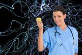 Surgeon holding an apple — Stock Photo
