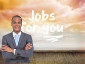 Charismatic young businessman with arms crossed — Stock Photo