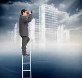 Businessman standing on ladder — Stock Photo