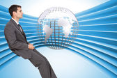 Classy young businessman sitting — Stock Photo
