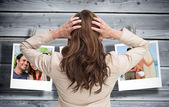 Businesswoman with hands on head standing back to camera — Stock Photo