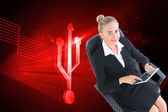 Businesswoman sitting on swivel chair with tablet — Stock Photo