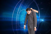 Composite image of businessman hanging — Stock Photo