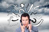 σύνθετη εικόνα της θυμωμένος επιχειρηματίας κουβάρι επάνω σε τηλέφωνο καλώδια — Φωτογραφία Αρχείου