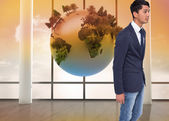 Composite image of unsmiling casual businessman walking — Stock Photo