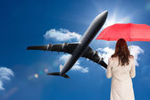 Businesswoman standing back to camera holding red umbrella — Foto Stock