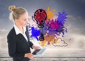 составное изображение бизнесвумен, держа планшет — Стоковое фото