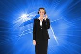 Good looking woman in suit using headphones — Zdjęcie stockowe