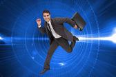 Cheerful businessman in a hury — Stock Photo