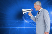 Businessman shouting in loudspeaker — Photo