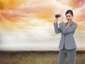 Businesswoman posing with binoculars — Stock Photo