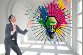 Composite image of screaming businessman catching — Stock Photo