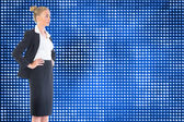 Blonde businesswoman standing with hands on hips — Stock Photo