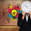 Composite image of businesswoman in suit holding a clock — Stock Photo #38502547