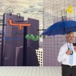 Happy businessmholding umbrella — Stock Photo #38504031