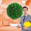 Serious architect holding plans and hard hat — Stockfoto