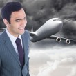 Composite image of smiling businessman standing — Foto Stock