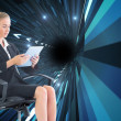 Stock Photo: Businesswomsitting on swivel chair with tablet