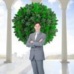 Assertive businessman standing — Stock Photo