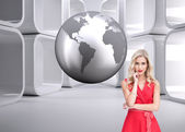 Composite image of thoughtful blonde wearing red dress — Stockfoto