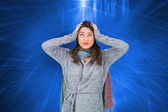 Composite image of anxious pretty brunette wearing winter clothes — Foto Stock
