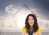Smiling casual young woman holding binoculars — Stock Photo