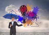 Paraguas empresario celebración azul — Foto de Stock
