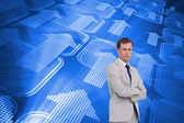 Businessman standing with his arms folded — Stock Photo