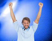 Man celebrating success with arms up — Stock Photo